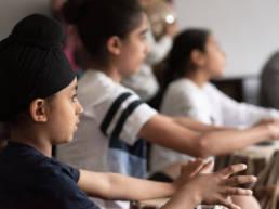 Image: Young Student at Gurmat Sangeet Academy Class